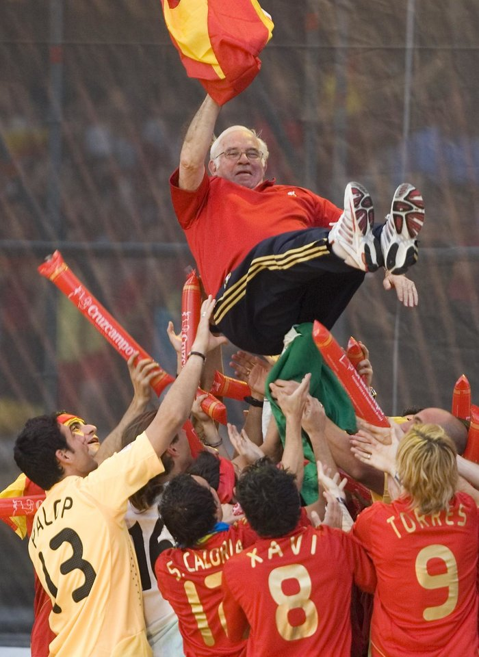 Photo - FILE - In this June 30, 2008 file photo, players of the Spanish national soccer team lift coach Luis Aragones in the air during a homecoming event in Madrid after winning the Euro 2008 European Soccer Championships final against Germany. Spanish football federation said former Spain coach Aragones has died, aged 75. As a player he played for Spain 11 times and coached  several Spanish clubs including Atletico Madrid and Barcelona before going on to coach the Spanish national team, winning the Euro 2008 European Soccer Championships. (AP Photo/Victor R. Caivano, File)