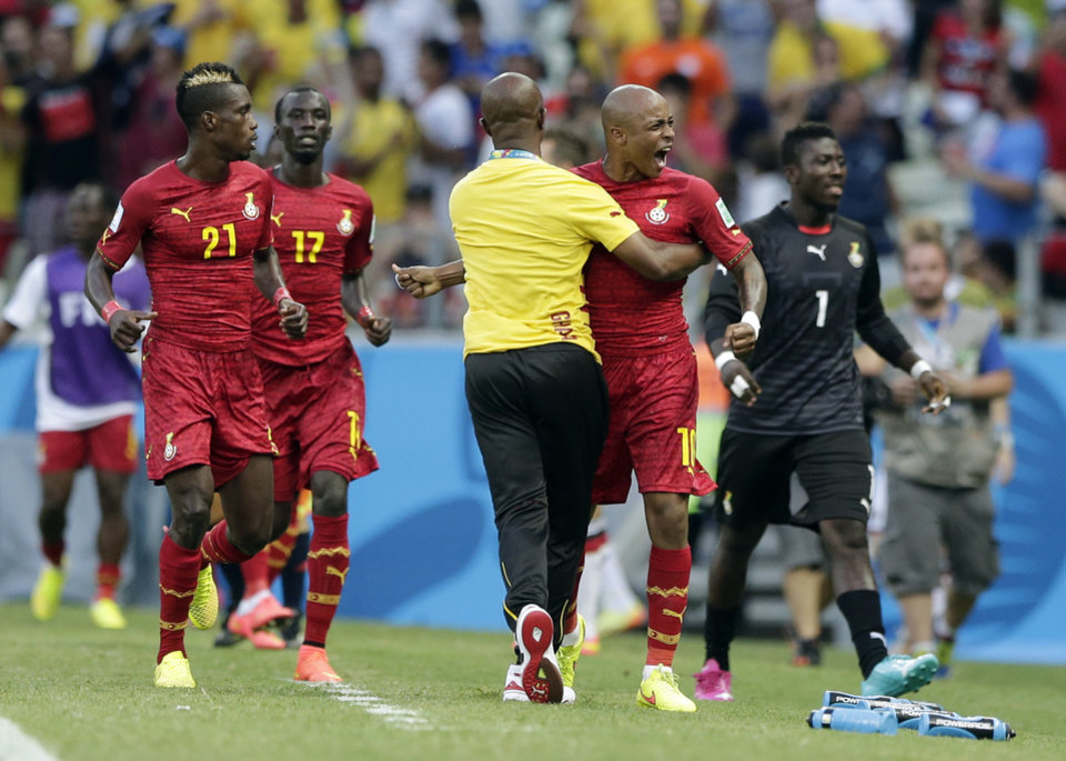 Photo - Ghana's Andre Ayew, right, celebrates after scoring his side's first goal during the group G World Cup soccer match between Germany and Ghana at the Arena Castelao in Fortaleza, Brazil, Saturday, June 21, 2014.  (AP Photo/Matthias Schrader)
