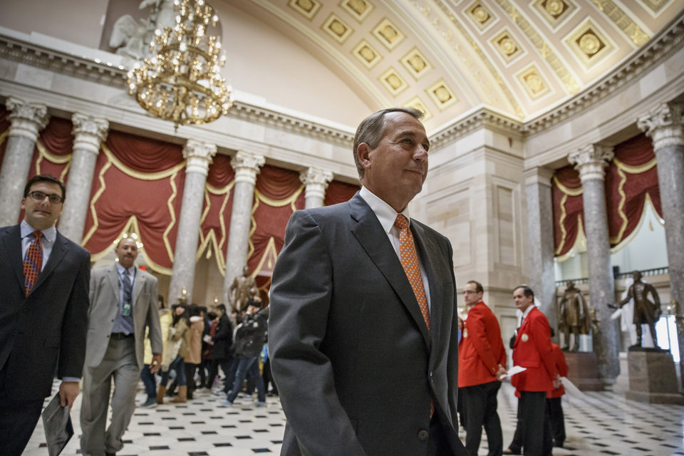 Photo - House Speaker John Boehner of Ohio leaves the House chamber on Capitol Hill in Washington, Monday, Jan. 27, 2014, after hearing the resignation letter submitted by Rep. Trey Radel, R-Fla. Radel, whose district includes the Florida Gulf Coast communities of Fort Myers and Naples, was caught buying cocaine in November from an undercover federal agent in Washington. Tomorrow, President Barack Obama will deliver his State of the Union address to a joint session of Congress. (AP Photo/J. Scott Applewhite)