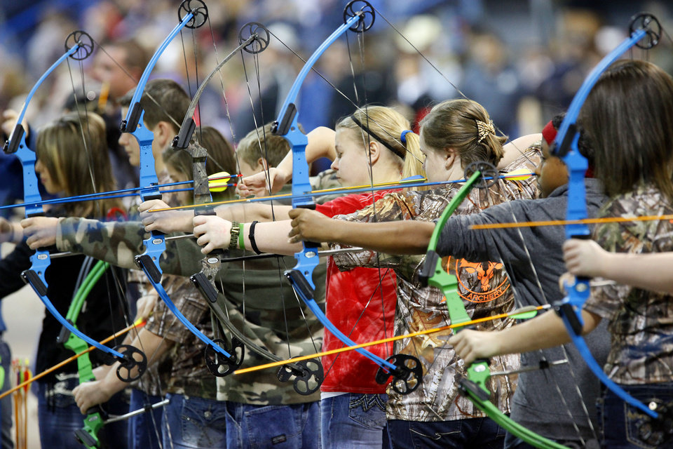 Photo - Students participate in the Archery in the Schools state shoot on Wednesday.  Photo By David McDaniel, The Oklahoman
