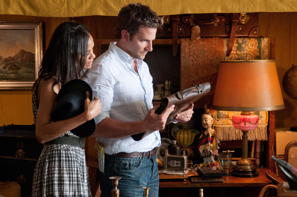 Photo -   This film image released by CBS Films shows Bradley Cooper, right, and Zoë Saldana in a scene from