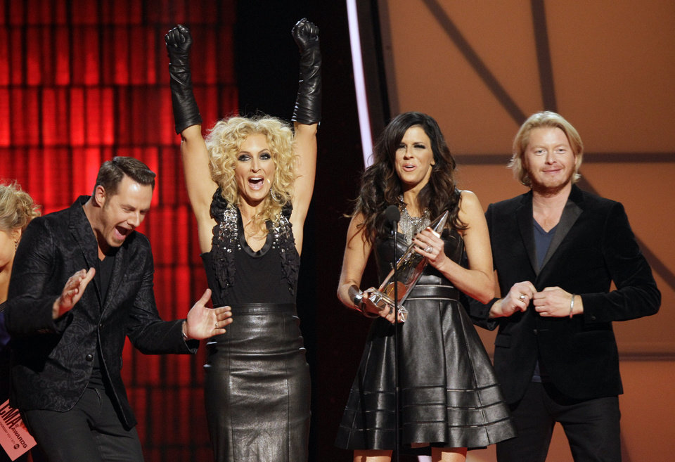 Photo -   Jimi Westbrook, from left, Kimberly Schlapman, Karen Fairchild and Phillip Sweet, of Little Big Town, accept the award for vocal group of the year at the 46th Annual Country Music Awards at the Bridgestone Arena on Thursday, Nov. 1, 2012, in Nashville, Tenn. (Photo by Wade Payne/Invision/AP)