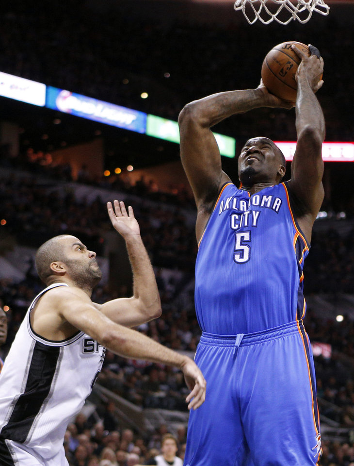 Photo - Oklahoma City's Kendrick Perkins (5) shoots beside San Antonio's Tony Parker (9) during Game 1 of the Western Conference Finals in the NBA playoffs between the Oklahoma City Thunder and the San Antonio Spurs at the AT&T Center in San Antonio, Monday, May 19, 2014. Photo by Sarah Phipps, The Oklahoman
