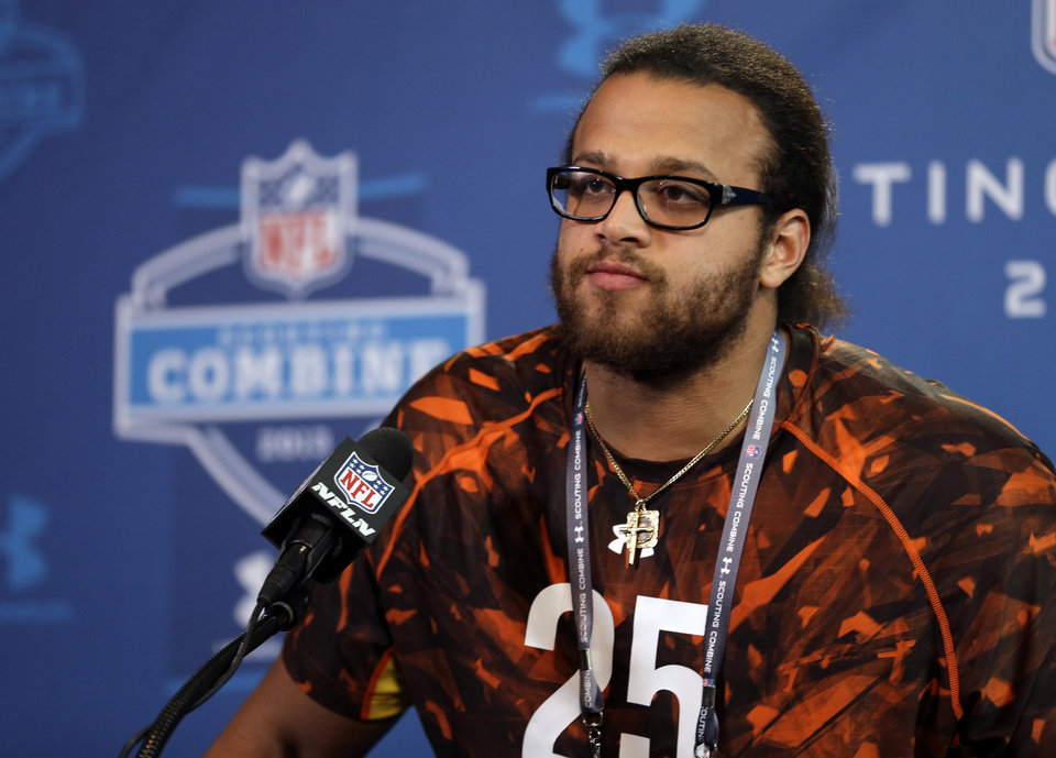 Photo - Southern California offensive lineman Khaled Holmes answers a question during a news conference at the NFL football scouting combine in Indianapolis, Thursday, Feb. 21, 2013. (AP Photo/Michael Conroy)