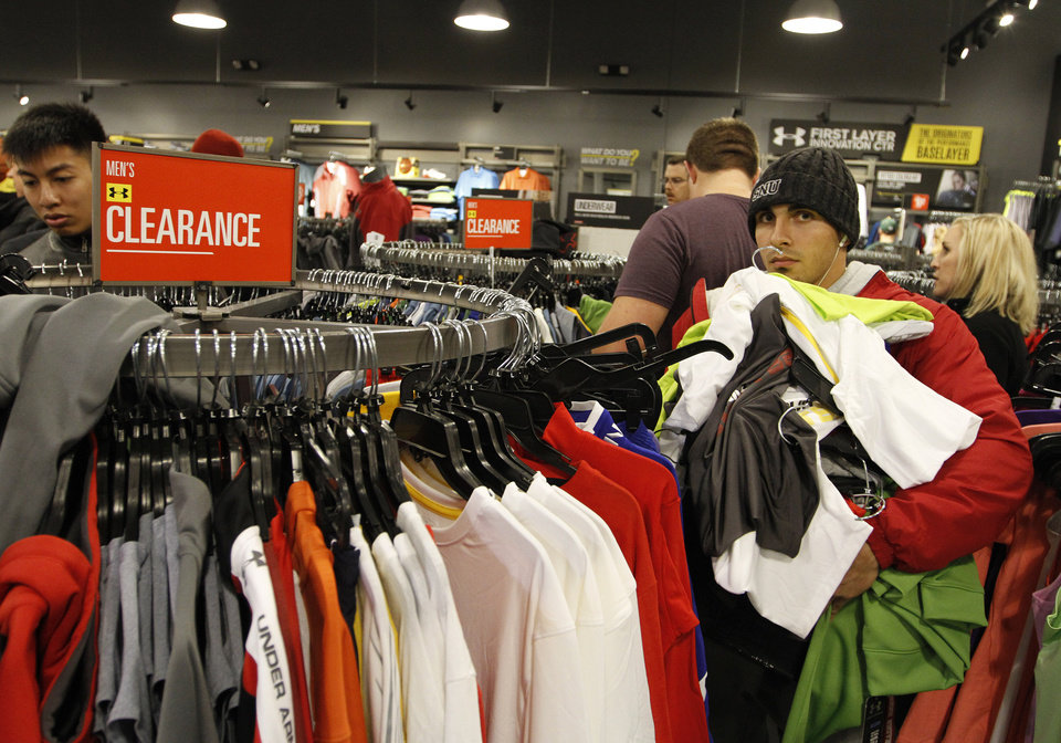 Jacob Cervantes, of Oklahoma City, loads up on clothes at Under Armour during Black Friday at The Outlet Shoppes at Oklahoma City, Thursday, Nov. 24, 2011.  Photo by Garett Fisbeck, For The Oklahoman