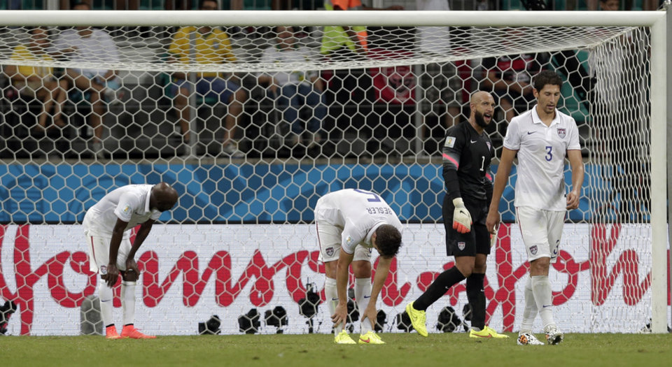 Photo - USA players react after Belgium's Romelu Lukaku scored his side's second goal in extra time during the World Cup round of 16 soccer match between Belgium and the USA at the Arena Fonte Nova in Salvador, Brazil, Tuesday, July 1, 2014. (AP Photo/Marcio Jose Sanchez)