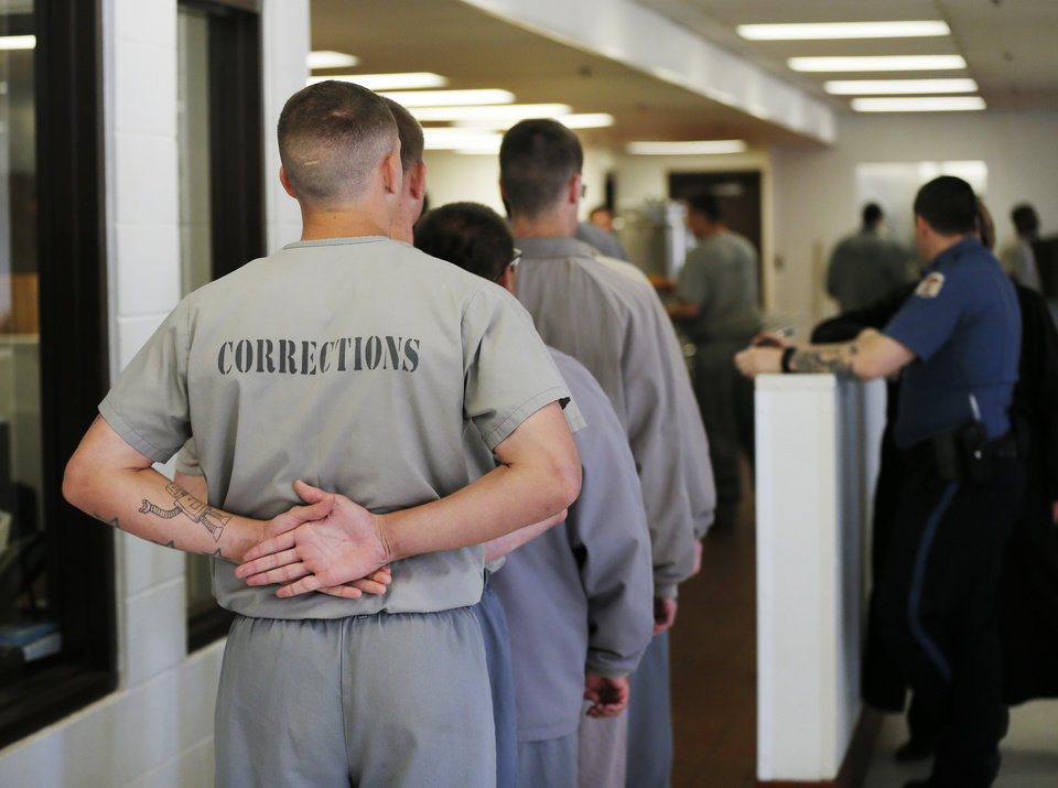 Photo -  Inmates line up for lunch. [Photo by Nate Billings, The Oklahoman]