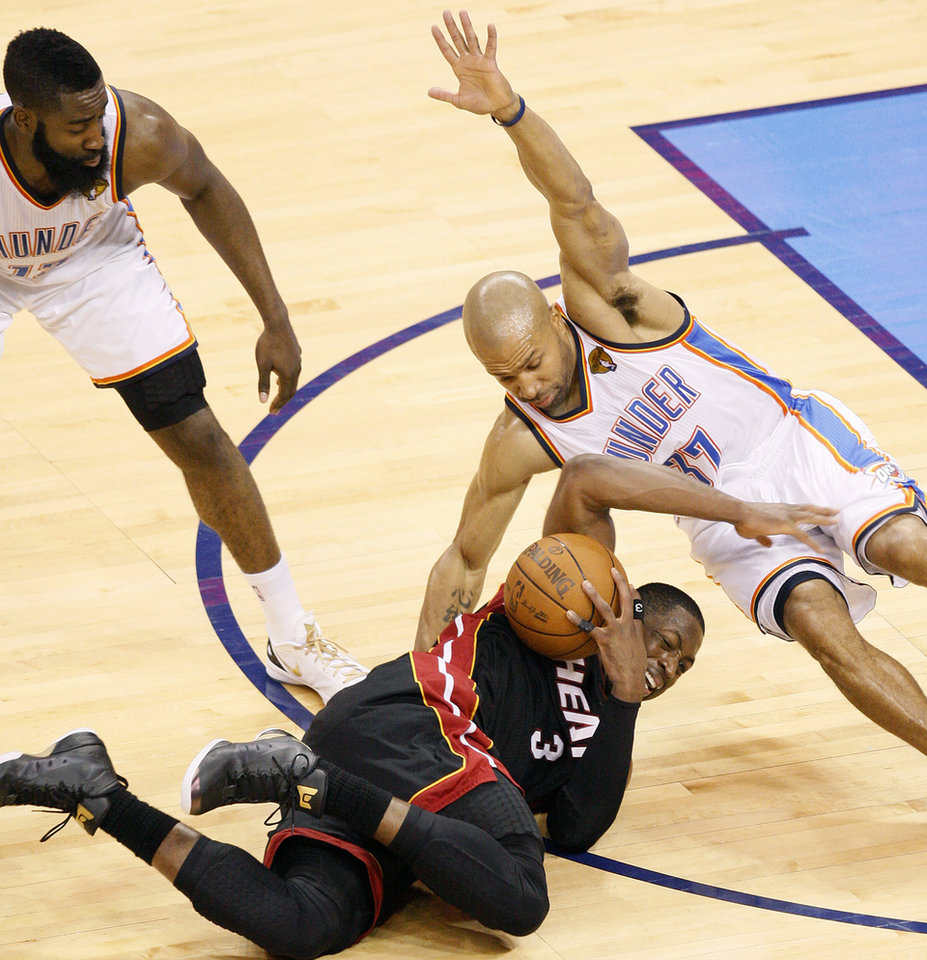 Oklahoma City's Derek Fisher (37) and Miami's Dwyane Wade (3) go for the ball as James Harden (13) watches during Game 2 of the NBA Finals between the Oklahoma City Thunder and the Miami Heat at Chesapeake Energy Arena in Oklahoma City, Thursday, June 14, 2012. Photo by Nate Billings, The Oklahoman