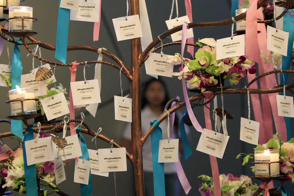 Photo - Well-wishes cards for passengers aboard the missing Malaysia Airlines Flight MH370 are tied during a mass prayer for the plane, in Kuala Lumpur, Malaysia, Sunday, April 6, 2014. The head of the multinational search for the missing Malaysia airlines jet said that electronic pulses reportedly picked up by a Chinese ship are an encouraging sign but stresses they are not yet verified. (AP Photo/Lai Seng Sin)