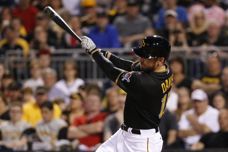 Photo - Pittsburgh Pirates' Ike Davis (15) hits his first home run since being acquired from the New York Mets this past week,  a grand slam off Cincinnati Reds starting pitcher Mike Leake during the fourth inning of a baseball game in Pittsburgh Monday, April 21, 2014. (AP Photo/Gene J. Puskar)