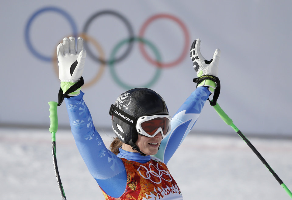 Photo - Slovenia's Tina Maze waves from the finish area after finishing the downhill portion of the women's supercombined at the Sochi 2014 Winter Olympics, Monday, Feb. 10, 2014, in Krasnaya Polyana, Russia. (AP Photo/Christophe Ena)