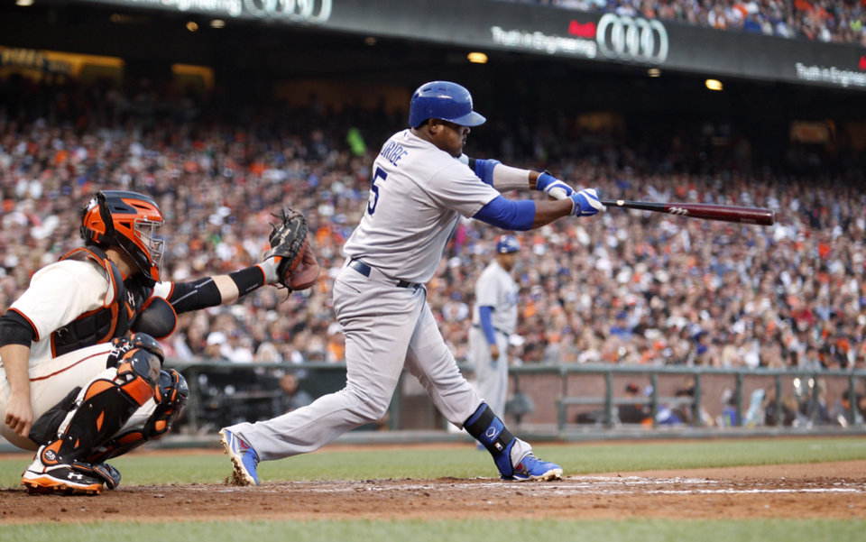 Photo - Los Angeles Dodgers' Juan Uribe hits an RBI double during the sixth inning of a baseball game against the San Francisco Giants, Saturday, July 26, 2014, in San Francisco. (AP Photo/Beck Diefenbach)