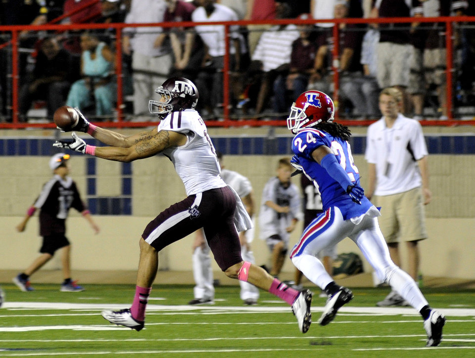 Texas A&M's Mike Evans, left, catches a 75-yard touchdown pass against Louisiana Tech during an NCAA college football game in Shreveport, La., Saturday, Oct. 13, 2012. (AP Photo/Kita K Wright)