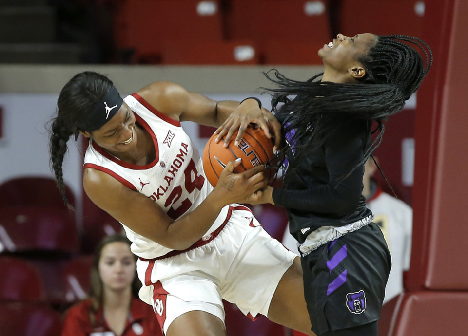 Photo - Oklahoma's Ijeoma Odimgbe (24) and Central Arkansas' Kamry Orr (2) fight for the ball during an NCAA women's basketball game between the University of Oklahoma (OU) and Central Arkansas at Loyd Noble Center in Norman, Okla., Wednesday, Dec. 5, 2018. Photo by Bryan Terry, The Oklahoman