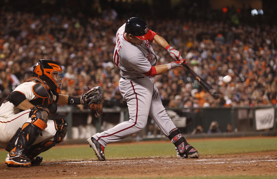 Photo - Washington Nationals' Wilson Ramos hits during the seventh inning of a baseball game against the San Francisco Giants, Monday, June 9, 2014, in San Francisco. (AP Photo/Beck Diefenbach)