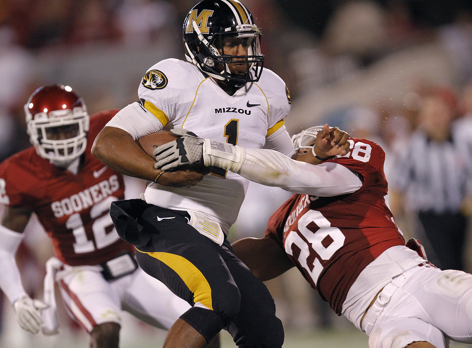 Oklahoma's Travis Lewis (28) stops Missouri's James Franklin (1) during the college football game between the University of Oklahoma Sooners (OU) and the University of Missouri Tigers (MU) at the Gaylord Family-Memorial Stadium on Saturday, Sept. 24, 2011, in Norman, Okla. Photo by Chris Landsberger, The Oklahoman