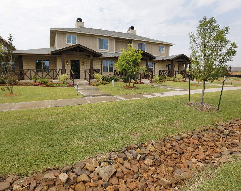 Photo - Johnston Builders has added townhomes to its Hawthorn addition near Hefner Road and N Pennsylvania Avenue in The Village.  Steve Gooch - The Oklahoman