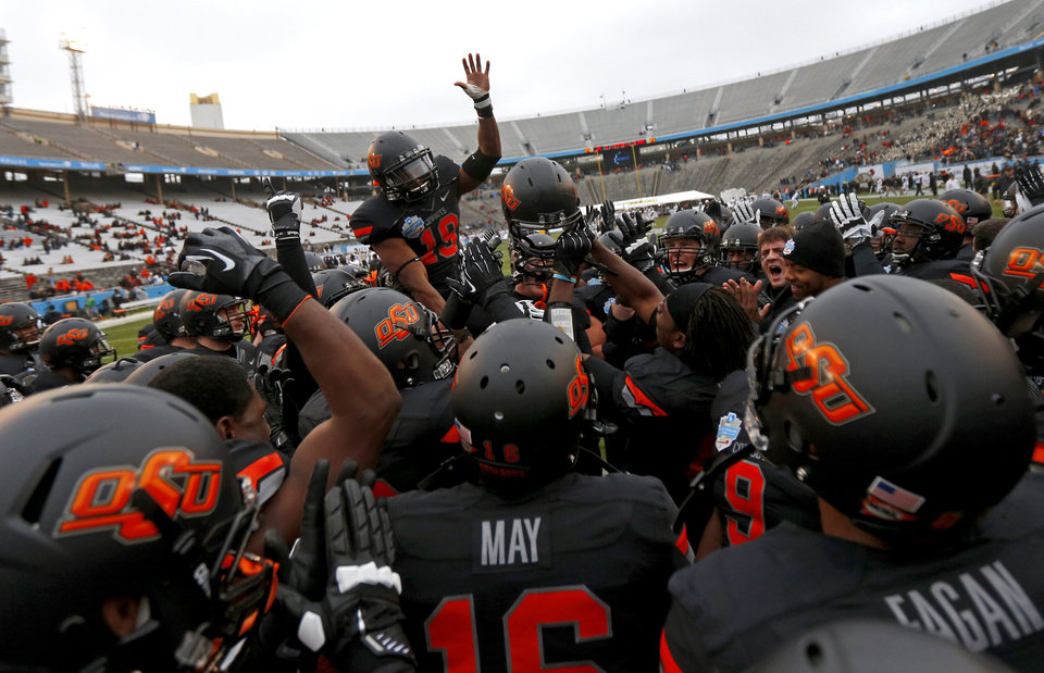 Photo - The Oklahoma State team gathers before the Heart of Dallas Bowl football game between Oklahoma State University and Purdue University at the Cotton Bowl in Dallas, Tuesday, Jan. 1, 2013. Photo by Bryan Terry, The Oklahoman
