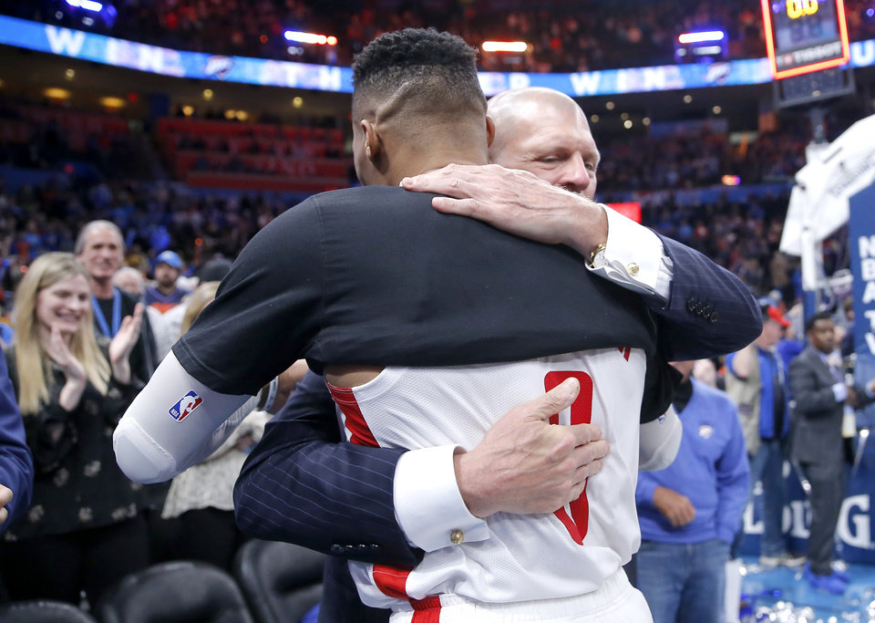 Photo - Houston's Russell Westbrook (0) hugs Clay Bennett following the NBA basketball game between the Oklahoma City Thunder and the Houston Rockets at the Chesapeake Energy Arena in Oklahoma City,  Thursday, Jan. 9, 2020.  [Sarah Phipps/The Oklahoman]