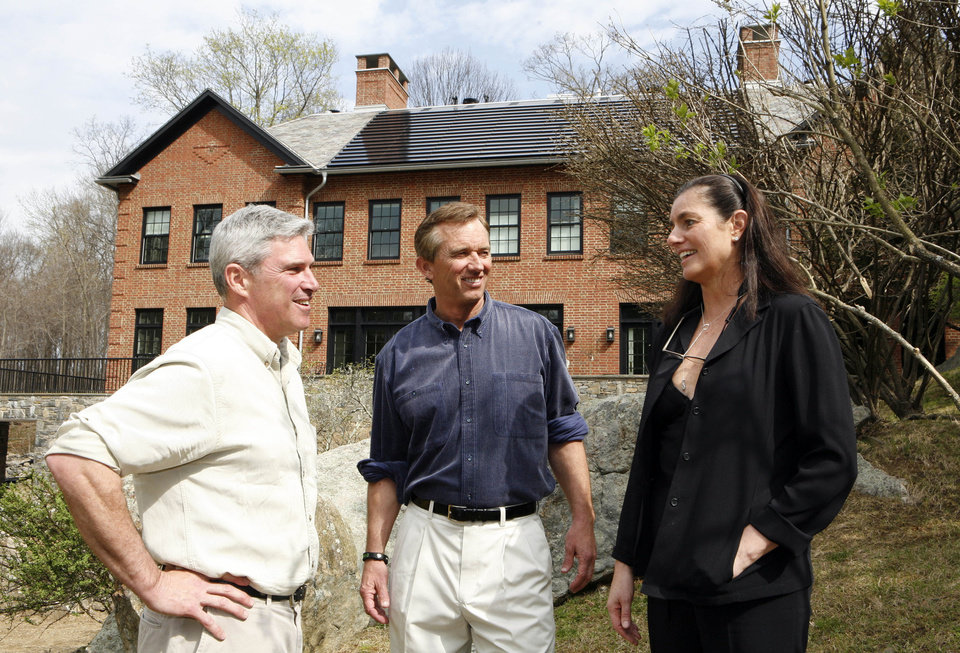 Photo -   In this photo of April 6, 2010, Robert Kennedy Jr., center, stands outside his home with his builder Jim Blansfield, left, and his wife Mary Richardson Kennedy. The estranged wife of Robert Kennedy Jr. was found dead at the family property, Wednesday, May 16, 2012, adding to the list of Kennedy family tragedies. She was an architect and designer and had overseen the renovation of the couple's home into an environmentally advanced showpiece. (AP Photo/Mark Vergari, The Journal News)
