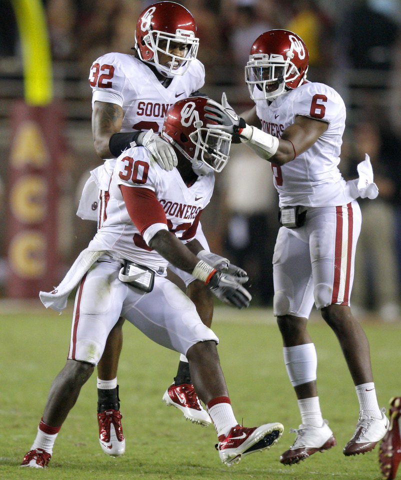 Oklahoma's Javon Harris (30) celebrates with Jamell Fleming (32), and Demontre Hurst (6) after Harris intercepted a pass during a college football game between the University of Oklahoma (OU) and Florida State (FSU) at Doak Campbell Stadium in Tallahassee, Fla., Saturday, Sept. 17, 2011. Oklahoma won 23-13. Photo by Bryan Terry, The Oklahoman