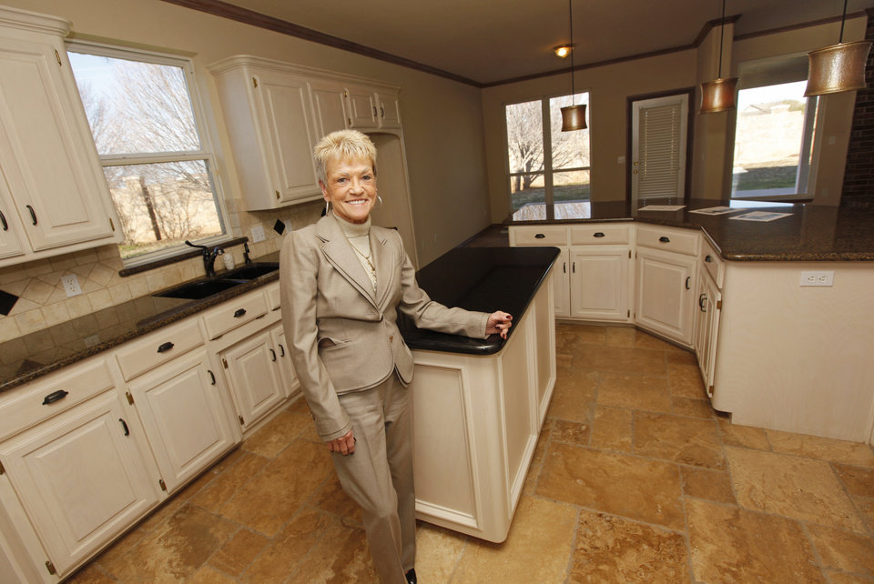 Real estate agent Mary Berry poses for a photo in the kitchen of one of her listings at 13504 Calistoga Drive in Oklahoma City, Friday, Dec. 30, 2011. Photo by Nate Billings, The Oklahoman