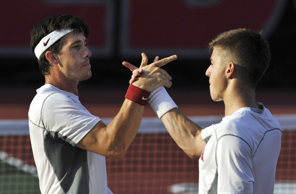 Photo - Oklahoma's Guillermo Alcorta, left, and Andrew Harris celebrate their win over Southern California's Connor Farren and Roberto Quiroz during a men's doubles match in the NCAA Division I team tennis championships, Tuesday, May 20, 2014, in Athens, Ga. (AP Photo/David Tulis)
