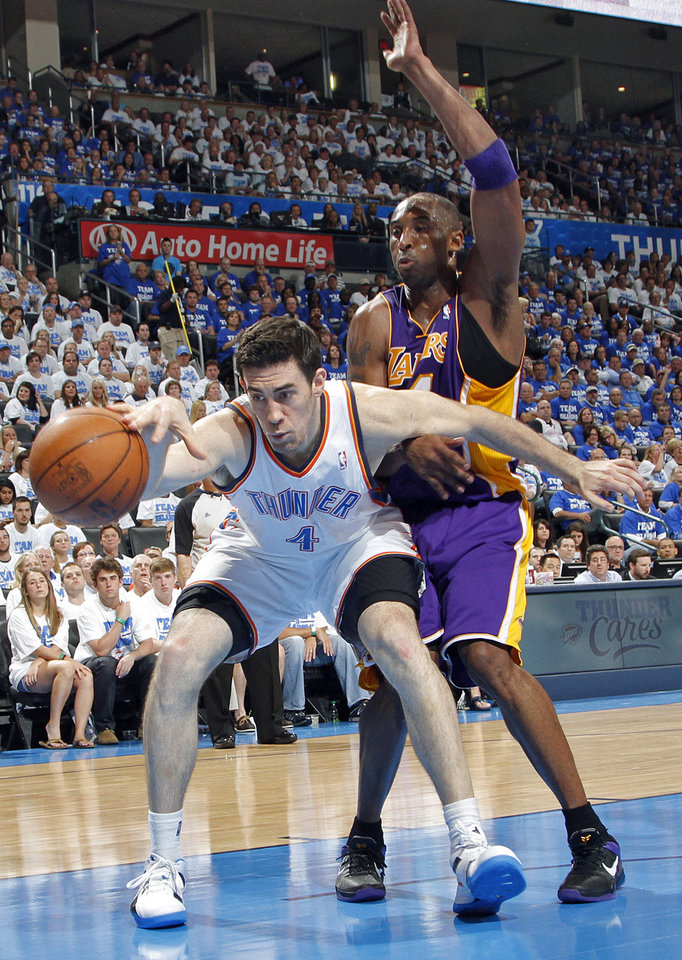 Oklahoma City's Nick Collison battles for the ball with Los Angeles' Kobe Bryant during Game 2 in the second round of the NBA playoffs between the Oklahoma City Thunder and the L.A. Lakers at Chesapeake Energy Arena on Wednesday,  May 16, 2012, in Oklahoma City, Oklahoma. Photo by Chris Landsberger, The Oklahoman