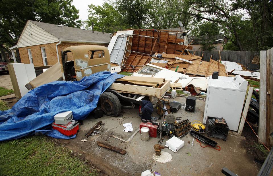 A garage smashed in Friday�s tornado is pushed up against a house at Kansas Street and Pickard Avenue.