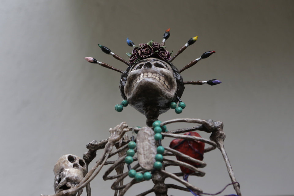 A skeleton sculpture depicting late Mexican artist Frida Kahlo stands on display at the Frida Kahlo museum in Mexico City, Tuesday, Oct. 2, 2012. A full collection from Kahlo's wardrobe will go on public display Nov. 22 in Mexico City after being locked for nearly 50 years in her armoires and dressers: jewelry, shoes and clothes that still carry the scent of the late artist's perfume and cigarette smoke or stains from painting. (AP Photo/Dario Lopez-Mills)