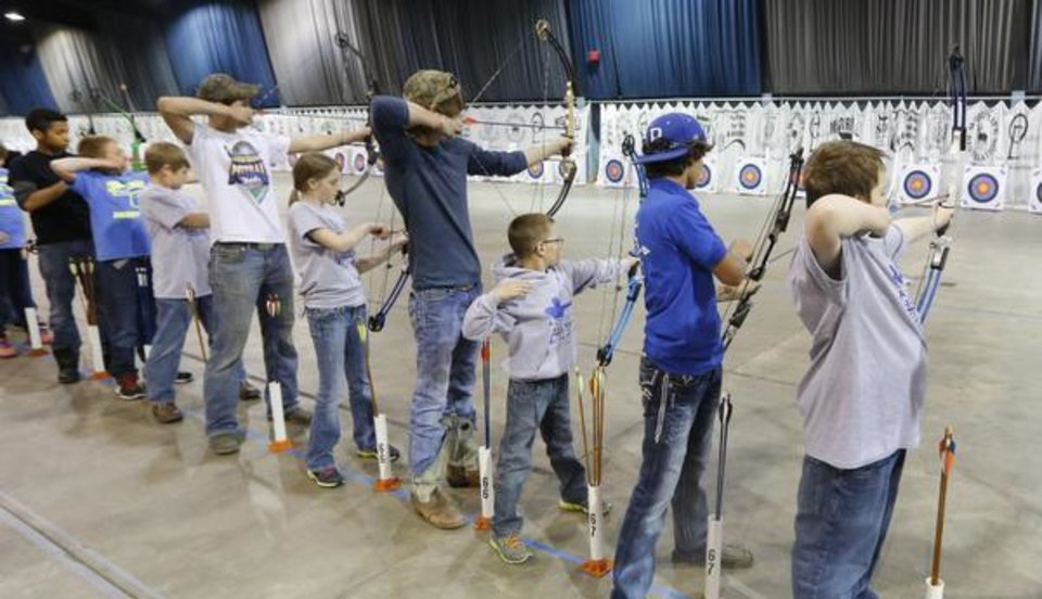 Photo -  Students compete in the State archery championships at State Fair Park in Oklahoma City, Wednesday March 26, 2014. Photo By Steve Gooch, The Oklahoman