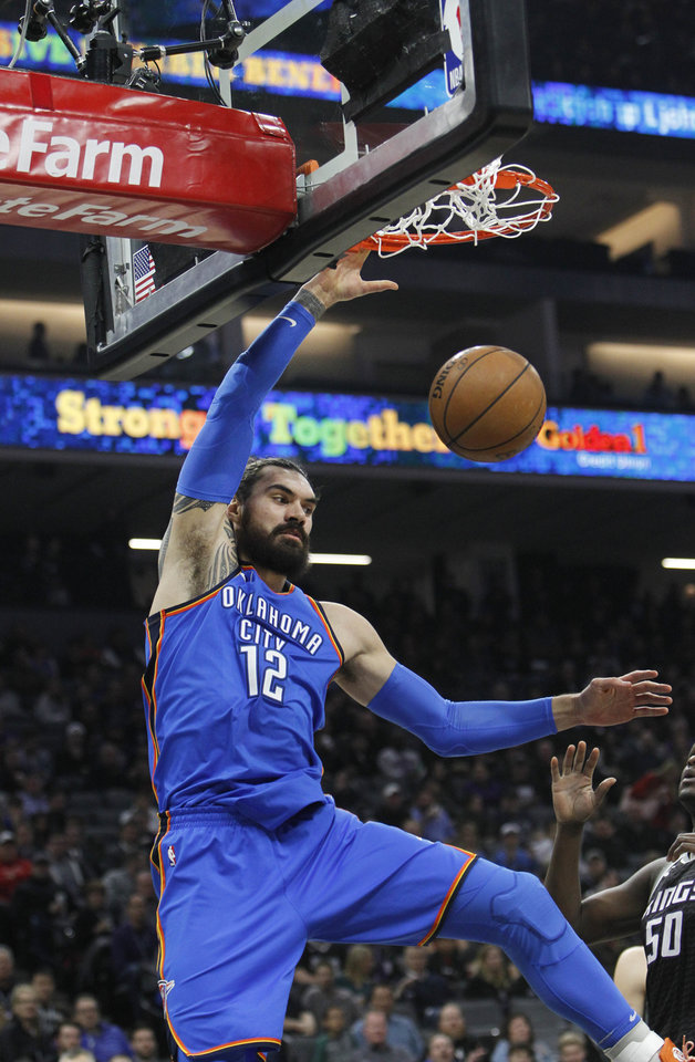 Photo - Oklahoma City Thunder center Steven Adams (12) breaks away for a dunk against the Sacramento Kings during the first half of an NBA basketball game in Sacramento, Calif., Thursday, Feb. 22, 2018. (AP Photo/Steve Yeater)