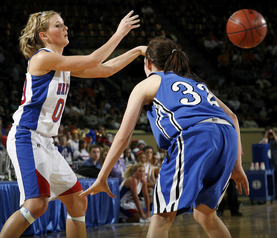 Photo - Hammon's Erin Burch (0) passes the ball away from Lomega's Taylor Mendell (32) during the Class B girls state championship high school basketball game between Hammon and Lomega at State Fair Arena in Oklahoma City, Saturday, March 3, 2012. Photo by Nate Billings, The Oklahoman