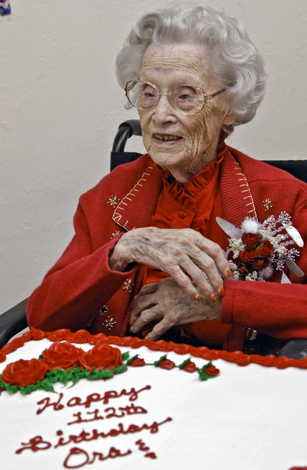 Photo - Ora E. Holland smiles during her early birthday celebration at Heritage Assisted Living Center on Saturday, Dec. 22, 2012, in Oklahoma City, Okla. Holland will celebrate her 112th birthday on Dec. 24, 2012.   Photo by Chris Landsberger, The Oklahoman