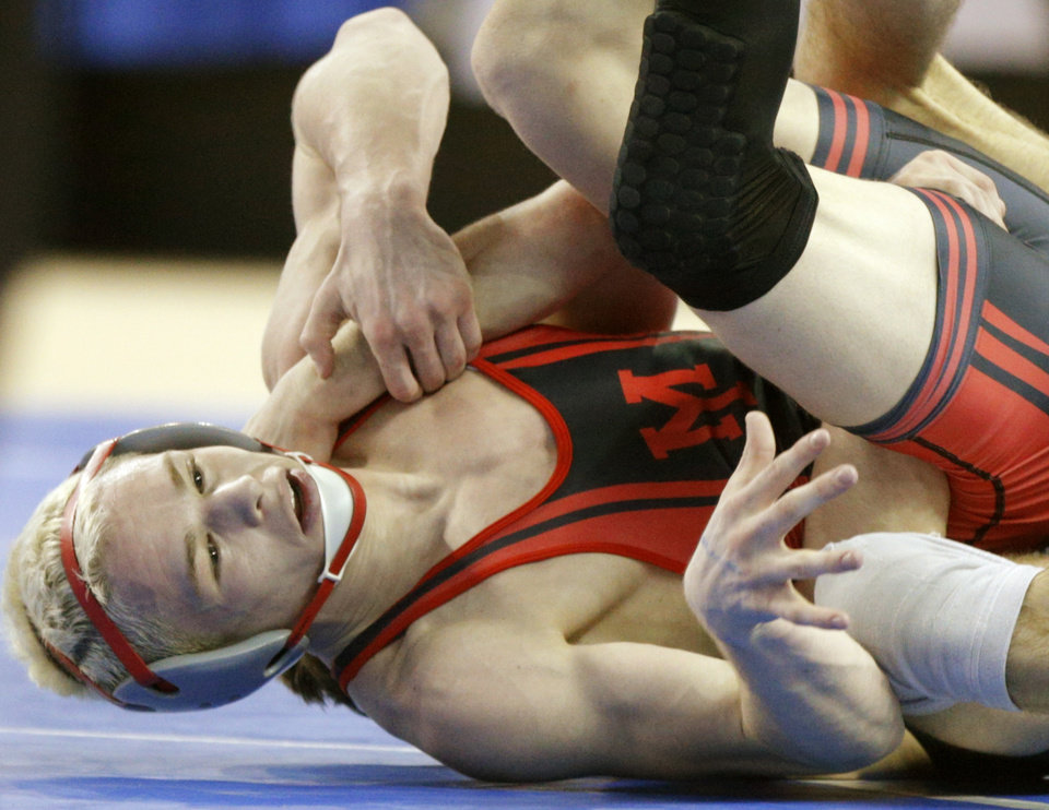 Photo - Yukon's Boo Lewallen wrestles Sand Spring's Cody Karstetter in a semifinal 126 pound match in the Class 6A state wrestling tournament at Jim Norick Arena at State Fair Park in Oklahoma City, Friday, Feb., 28, 2014. Photo by Bryan Terry, The Oklahoman