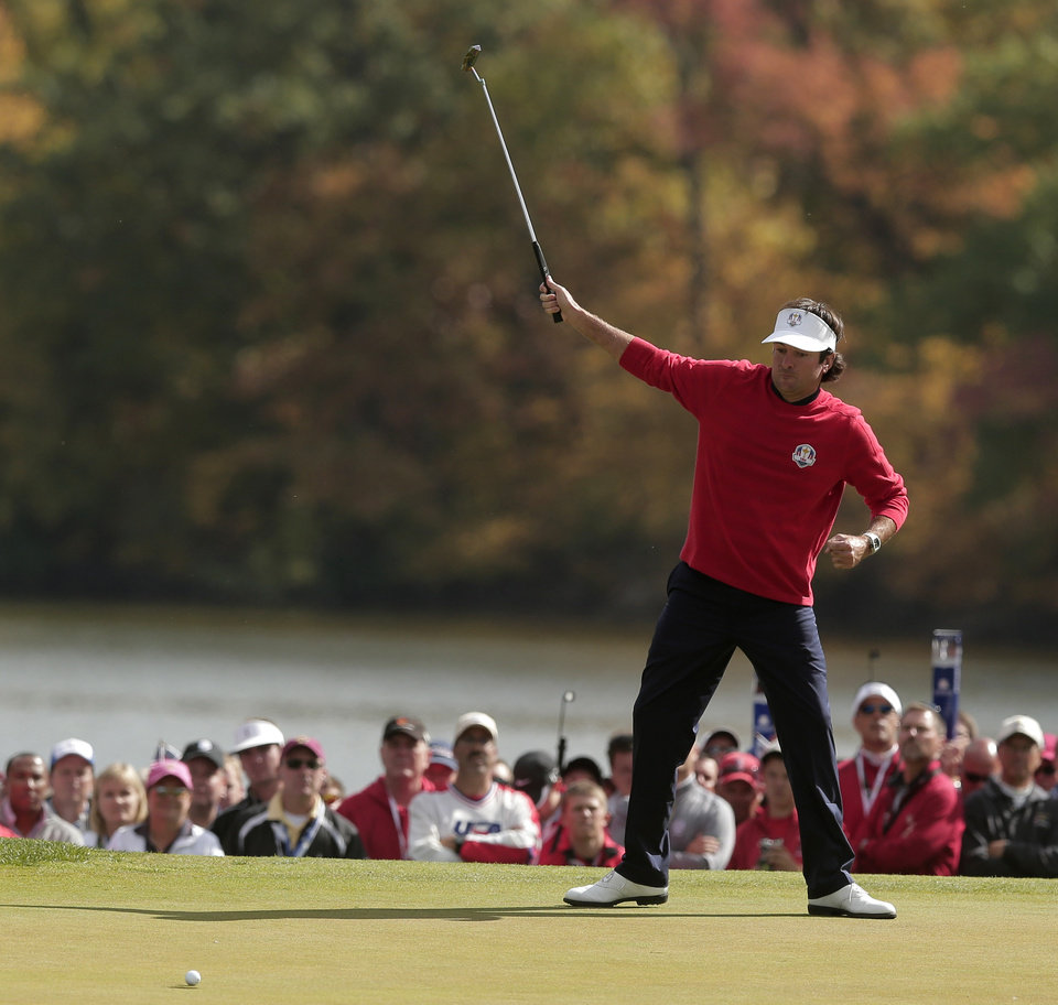Photo - USA's Bubba Watson reacts as he makes a putt on the first hole during a singles match at the Ryder Cup PGA golf tournament Sunday, Sept. 30, 2012, at the Medinah Country Club in Medinah, Ill. (AP Photo/Charlie Riedel)  ORG XMIT: PGA102