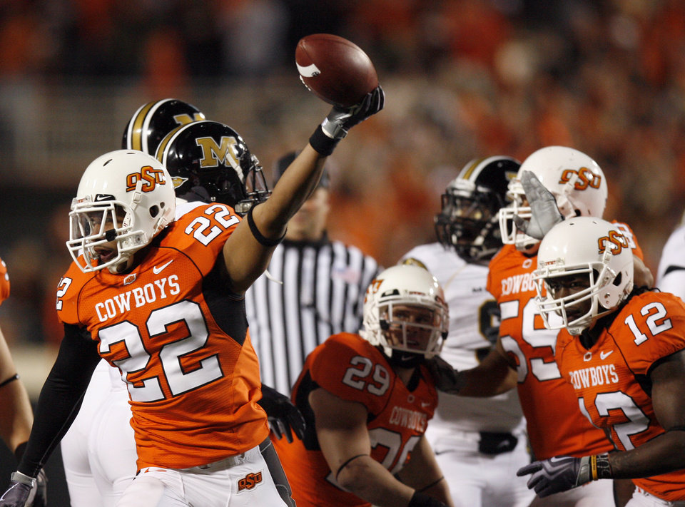 Photo - OSU's James Thomas (22) celebrates a fumble recovery during the college football game between Oklahoma State University (OSU) and the University of Missouri (MU) at Boone Pickens Stadium in Stillwater, Okla. Saturday, Oct. 17, 2009.  Photo by Sarah Phipps, The Oklahoman