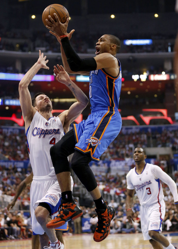 Photo - Oklahoma City's Russell Westbrook (0) goes to the basket between Los Angeles' J.J. Redick (4) and Chris Paul (3) during Game 4 of the Western Conference semifinals in the NBA playoffs between the Oklahoma City Thunder and the Los Angeles Clippers at the Staples Center in Los Angeles, Sunday, May 11, 2014. Photo by Nate Billings, The Oklahoman