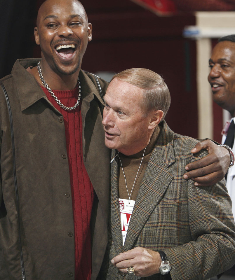 Former head basketball coach Billy Tubbs (right) is greeted by one of his players (89-90) Skeeter Henry before the University of Oklahoma (OU) men's college basketball team plays Texas A&M at the Lloyd Noble Center in Norman, Oklahoma on Saturday, February 17, 2007.   Photo by Steve Sisney/The Oklahoman