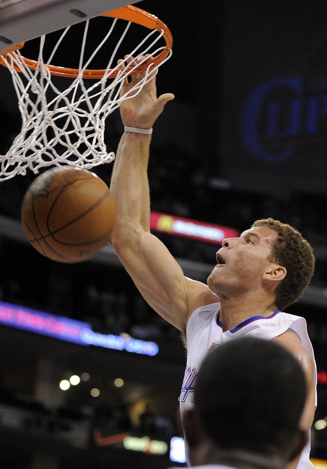 Photo - Los Angeles Clippers forward Blake Griffin dunks during the first half of an NBA basketball game against the Oklahoma City Thunder, Wednesday, Nov. 3, 2010, in Los Angeles.  (AP Photo/Mark J. Terrill)