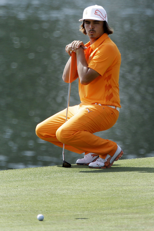 Photo -   Rickie Fowler reacts after missing a birdie putt on the 14th hole during the final round of the Wells Fargo Championship golf tournament at Quail Hollow Club in Charlotte, N.C., Sunday, May 6, 2012. Fowler won the tournament on the first playoff hole. (AP Photo/Chuck Burton)