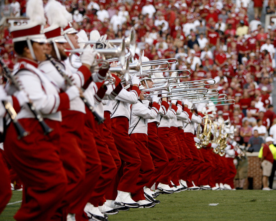 Photo - The Pride of Oklahoma takes the field before the college football game between the University of Oklahoma Sooners (OU) and the University of Missouri Tigers (MU) at the Gaylord Family-Memorial Stadium on Saturday, Sept. 24, 2011, in Norman, Okla. Photo by Bryan Terry, The Oklahoman