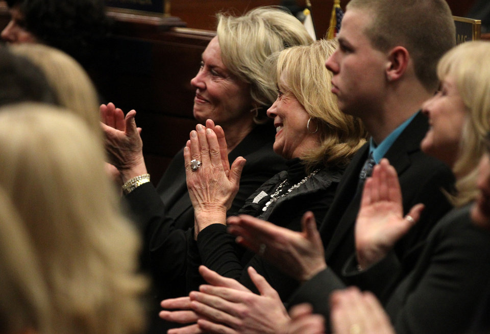 Photo - Dale Raggio, left, the widow of former Senator Bill Raggio and former first lady Dema Guinn react to Nevada Gov. Brian Sandoval's State of the State address at the Legislature in Carson City, Nev., on Wednesday, Jan. 16, 2013. Sandoval proposed funding in his budget to continue the Kenny C. Guinn Millennium Scholarship fund. (AP Photo/Cathleen Allison)