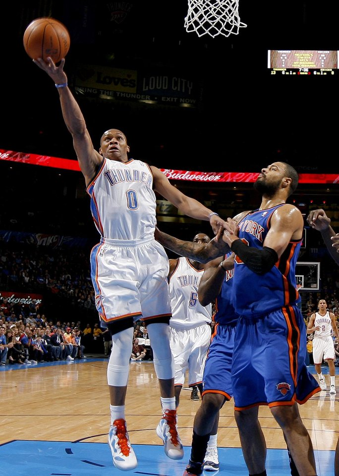 Russell Westbrook (0) goes past Tyson Chandler (6) during the NBA game between the Oklahoma City Thunder and the New York Knicks at Chesapeake Energy Arena in Oklahoma CIty, Saturday, Jan. 14, 2012. Photo by Bryan Terry, The Oklahoman
