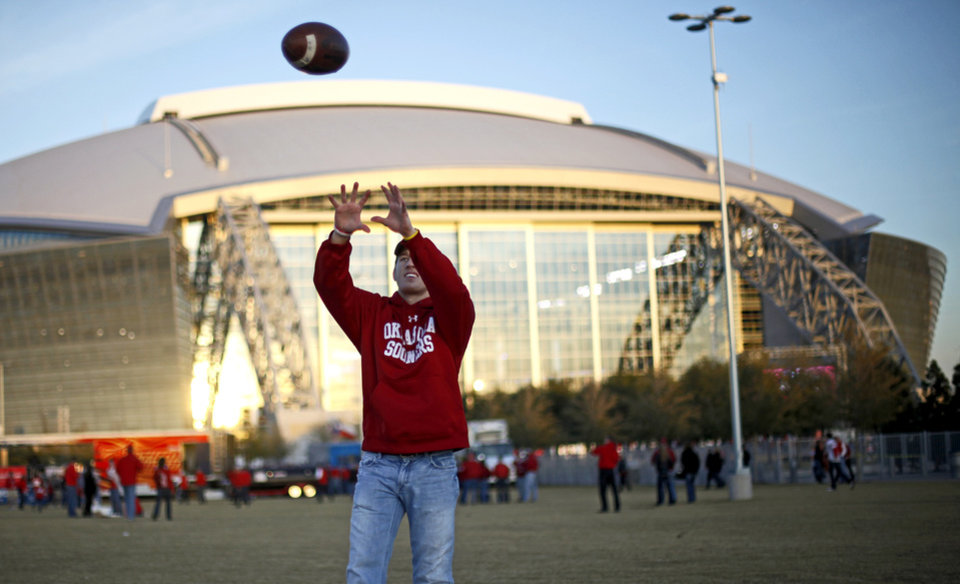 Chase McDonald of Beaumont, Texas, catches football before the Big 12 football championship game between the University of Oklahoma Sooners (OU) and the University of Nebraska Cornhuskers (NU) at Cowboys Stadium on Saturday, Dec. 4, 2010, in Arlington, Texas.  Photo by Bryan Terry, The Oklahoman