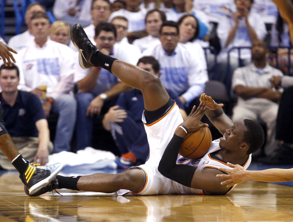 Photo - Oklahoma City's Reggie Jackson (15) calls for timeout after gaining control of a loose ball during Game 5 in the first round of the NBA playoffs between the Oklahoma City Thunder and the Memphis Grizzlies at Chesapeake Energy Arena in Oklahoma City, Tuesday, April 29, 2014. Photo by Sarah Phipps, The Oklahoman