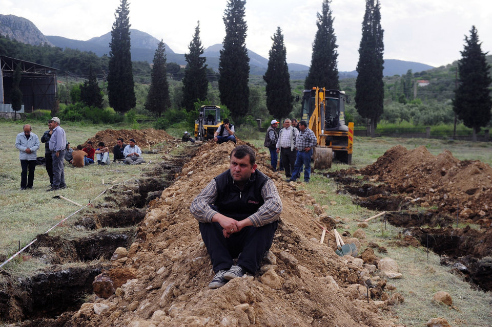 Photo - The rows of open graves for the mine accident victims in Soma, Turkey, Wednesday, May 14, 2014. Rescuers desperately raced against time to reach more than 200 miners trapped underground Wednesday after an explosion and fire at a coal mine killed at least 200 workers, Energy Minister Taner Yildiz said Wednesday.(AP Photo/Emre Tazegul)