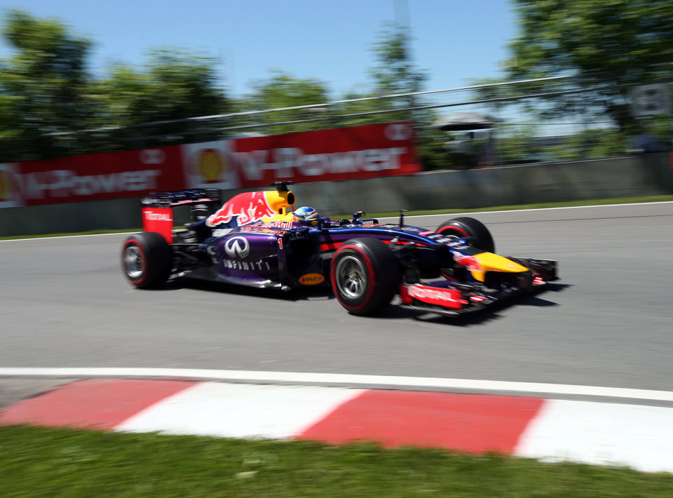 Photo - Red Bull driver Sebastian Vettel from Germany takes part in the morning practice session at Circuit Gilles Villeneuve Friday, June 6, 2014 in Montreal. The Canadian Grand Prix will be held Sunday, June 8, 2014. (AP Photo/The Canadian Press, Tom Boland)