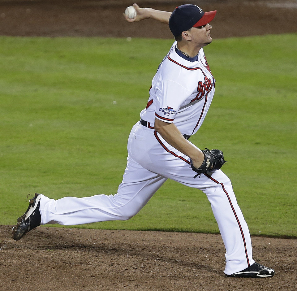 Photo - Atlanta Braves relief pitcher Luis Avilan works against the Los Angeles Dodgers in the seventh inning of Game 2 of the National League division series on Friday, Oct. 4, 2013, in Atlanta. (AP Photo/Mike Zarrilli)