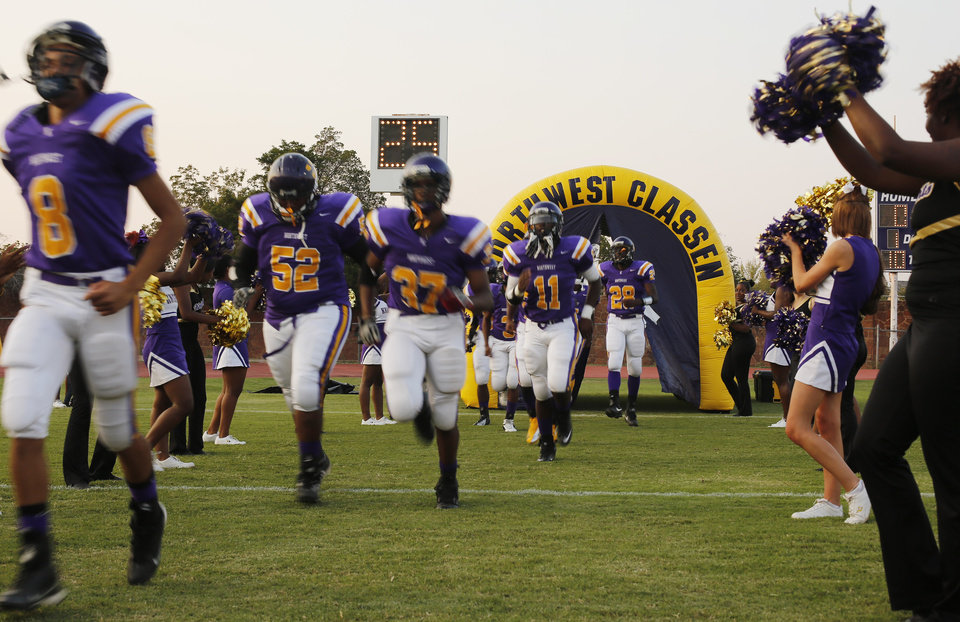 NWC players come onto the field at the Northwest Classen vs. Western Heights high school football game at Taft Stadium Thursday, September 20, 2012. Photo by Doug Hoke, The Oklahoman